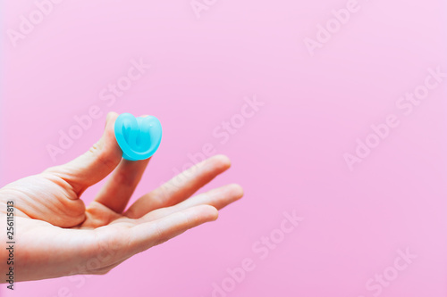 Fotografie, Obraz  Close up of woman hand folding menstrual cup showing how to use, c form
