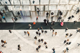Fototapeta Nowy York - People crowd walking in the business centre and shopping mall entrance. View from the top.