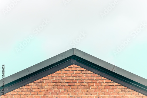 Fototapeta gable roof red brick house country style  concept idea against clear sky backgro