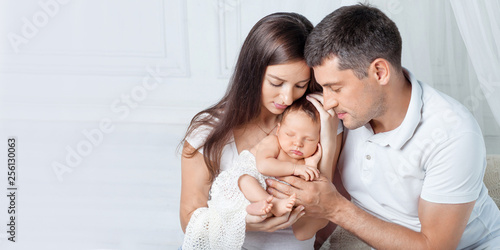 Woman and man holding a newborn Canvas Print