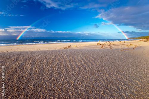 Rainbow over the sea beach