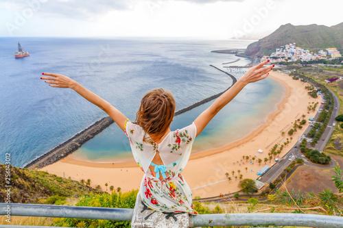 Poster de jardin Iles Canaries Traveler girl enjoying the beach in Tenerife