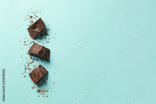 Fotografiet Sweet tasty chocolate on color background