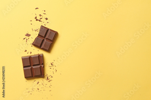 Sweet tasty chocolate on color background Fototapeta