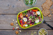 canvas print picture - Lunch box with salad on rustic wooden background with copy space