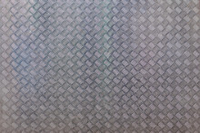 The Surface Of The Metal Sheet With The Industrial Pattern. As A Background