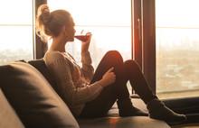 Woman Sitting On The Sofa, Dri...