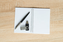 Pen And Flash Drive And Notepad On Wooden Background