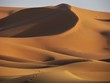 Spectacular views in Sahara Desert. Sun colours its Beautiful Sand Dunes and creates astonishing shadows effects. Camel trekking and night in tents is a must
