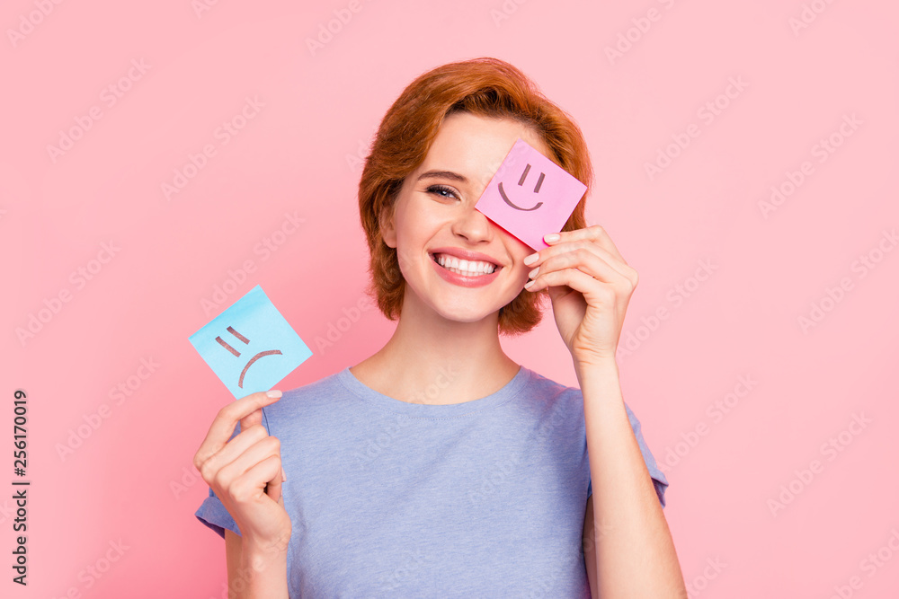 Fototapeta Close-up portrait of her she nice cute charming attractive cheerful girl wearing casual blue t-shirt holding in hands two draw notes positive good choice isolated on pink pastel background