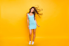 Full Length Body Size Photo Beautiful Her She Lady Ideal Shape Fit Tanned Body Posing Hair Flight Wearing White Shoes Sneakers Blue Teal Green Everyday Short Dress Clothes Isolated Yellow Background