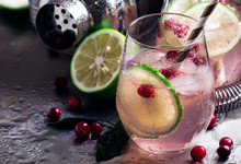 Lemonade With Lime, Cranberries, Sugar Syrup And Ice, Soft Drink, Steel Background, Bar Tools, Selective Focus
