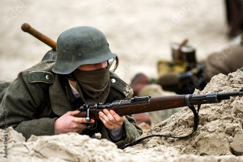 A German soldier in a trench with a rifle in his hand Wallpaper Mural