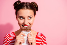 Close-up Portrait Of Her She Nice Cute Charming Attractive Glamorous Cheerful Sly Cunning Hungry Girl In Striped T-shirt Biting Tasting Eating Desirable Favorite Dessert Isolated On Pink Background
