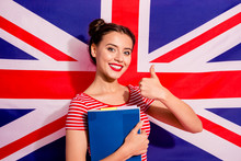Close-up Portrait Of Nice Cute Charming Lovely Adorable Attractive Cheerful Cheery Teen Girl Wearing Striped T-shirt Bachelor Master Degree Showing Thumbup Isolated Over British Flag Background