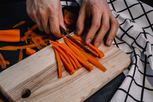 Cutting Carrot On A Wooden Boa...