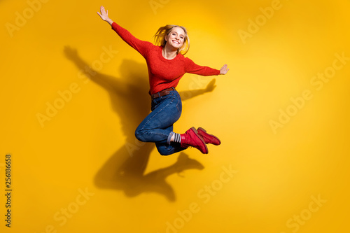 Obraz Full length body size view of her she nice attractive cool lovely cheerful cheery optimistic girl having fun free time isolated over bright vivid shine orange background - fototapety do salonu