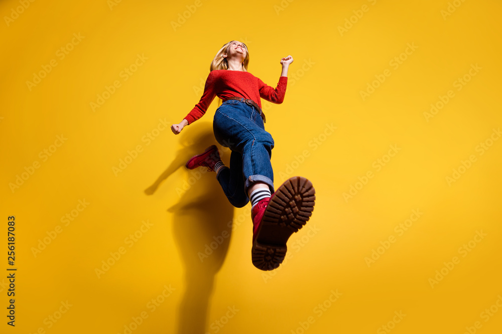 Fototapeta Low below angle full length body size view of nice attractive cheerful girl having fun going making step wearing vintage retro maroon boots isolated over bright vivid shine orange background