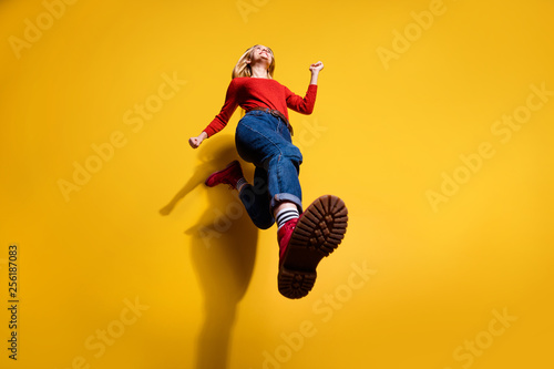Low below angle full length body size view of nice attractive cheerful girl having fun going making step wearing vintage retro maroon boots isolated over bright vivid shine orange background - fototapety na wymiar