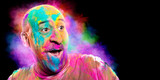 Bald smiling man with colorful face having fun. Holi color festival