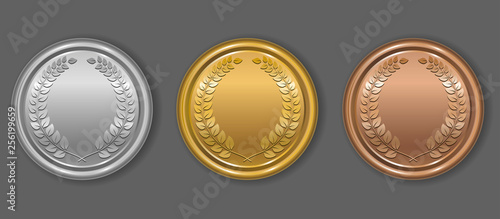 Obraz na plátně Gold, silver and bronze award medals with laurel wreath