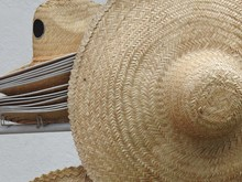 Several Straw Hats On Display ...