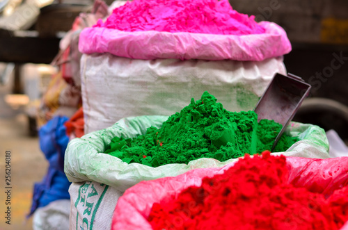 Foto auf AluDibond Spa Gunny bags of organic Holi gulal colors on display for sale in old Delhi street market. Holi is the festival of colors which is widely celebrated in North India