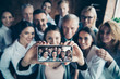 canvas print picture - Close up blurry photo business people different age race free time excited team building hug embrace cuddle she her he him his telephone smart phone make take selfies  formal wear jackets shirts