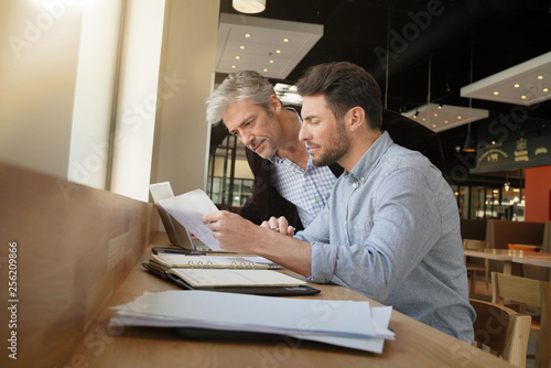 Fototapety, obrazy: Salesman coworkers going through sales pitch on work trip
