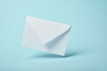 White And Blank Envelope On Blue Background With Copy Space