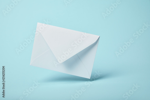 Fototapeta white and blank envelope on blue background with copy space obraz