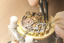 Professional Watchmaker Repairing Watch