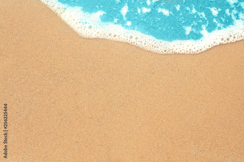 Fototapeta Sea sand and surf texture background. Vacation on ocean beach, summer holiday concept