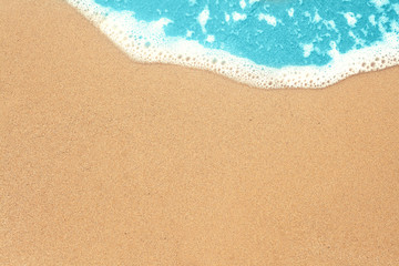 Sea sand and surf texture background. Vacation on ocean beach, summer holiday concept