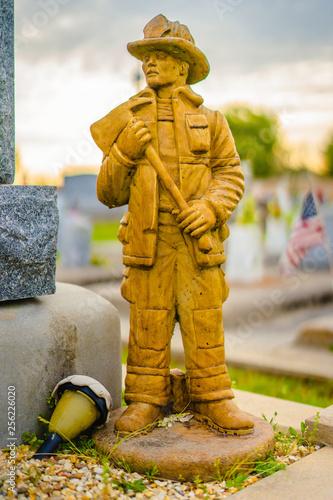 A aged alabaster firemen grave statue on a grave Canvas Print