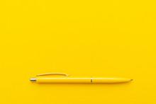 Yeloow Ballpoint Pen On The Yellow Background