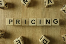 Pricing Word From Wooden Blocks On Desk