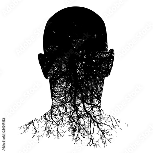 This silouette of a man's head morphs into roots in this black and white backgro Fototapet