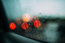 Defocused Lights Seen Through Wet Car Window In Rainy Season