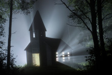 Light Emitting From Old Church In Forest At Night