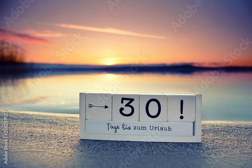 Fototapeta  30 Tage bis zum Urlaub