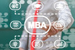 Man uses on a virtual screen of the future and touches the abbreviation: MBA. MBA Master of Business Administration Education concept.