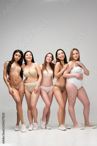 Fototapeta five pretty multiethnic girls in lingerie looking at camera and smiling, body positivity concept obraz na płótnie