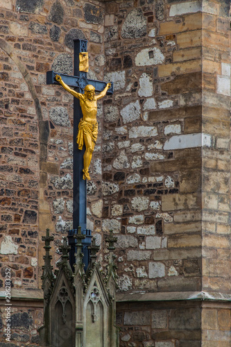 Photo  The gilded crucifix of Jesus Christ in the courtyard of the sabor Peter and Paul