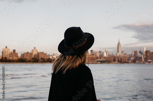 USA, New York, New York City, Brooklyn, woman with hat - 256288087