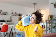 Carefree Woman Listening To Music With Portable Radio At Home