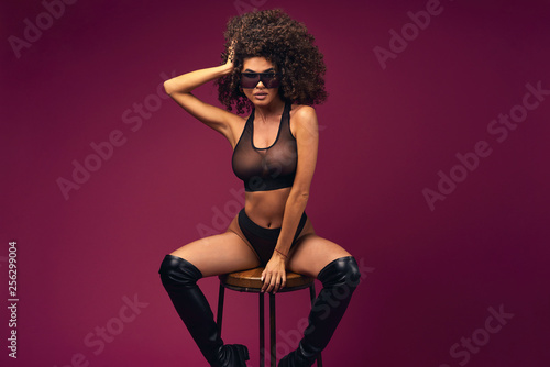 Fotografija  curly model in lingerie posing on a chair