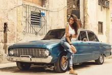 Woman Is Posing  Beside  Old Car