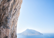 Greece, Kalymnos, Climber In Rock Wall Above The Sea