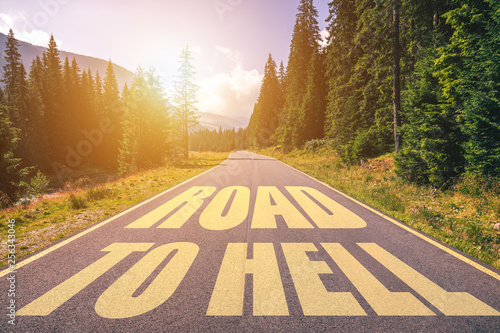 фотография Road to hell written on the street in the mountains